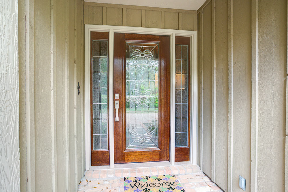 They Settled On A New Fleur De Lis Design Leaded Glass Door.